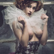 Sexy Pierrot woman behind the glass — Stock Photo