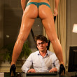 Sexy woman standing on a desk at the office — Stock Photo #11260561