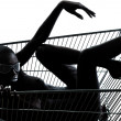 Woman naked in a caddy shopping cart — Stock Photo