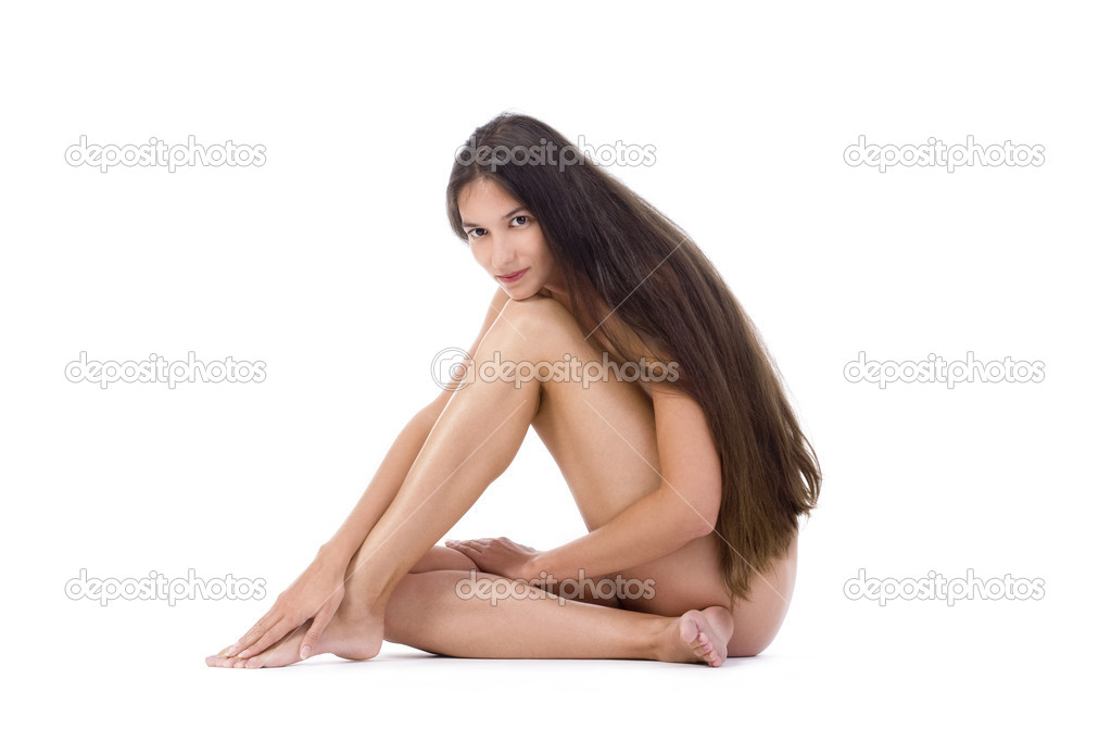 Beautiful nude woman with long hair sitting on the floor - isolated on white — Stock Photo #11277053
