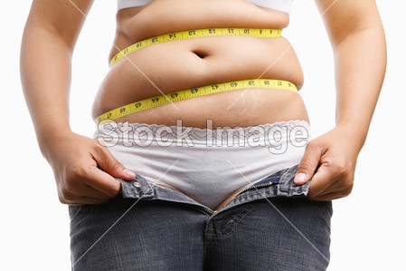 Photo for Fat woman holding her unzip jeans with measuring tape around her belly, a concept to get a diet - Royalty Free Image