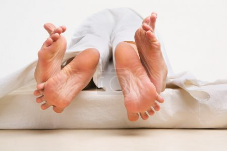 Feet of couple making love
